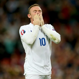 Wayne Rooney celebrates scoring his penalty at Wembley